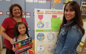 Congratulations Nevaeh Lira, 1st grade student at Fenwick Elementary School, our 2nd place winner in SAISDFoundation's 2017 Fiesta medal design competition. Miss Lira won gift of art supplies and her teacher, Ms. Fenton, received an art grant for her class. Pictured (l to r): Ms. Lira (Nevaeh's mother); Nevaeh Lira and Ms. Fenton.