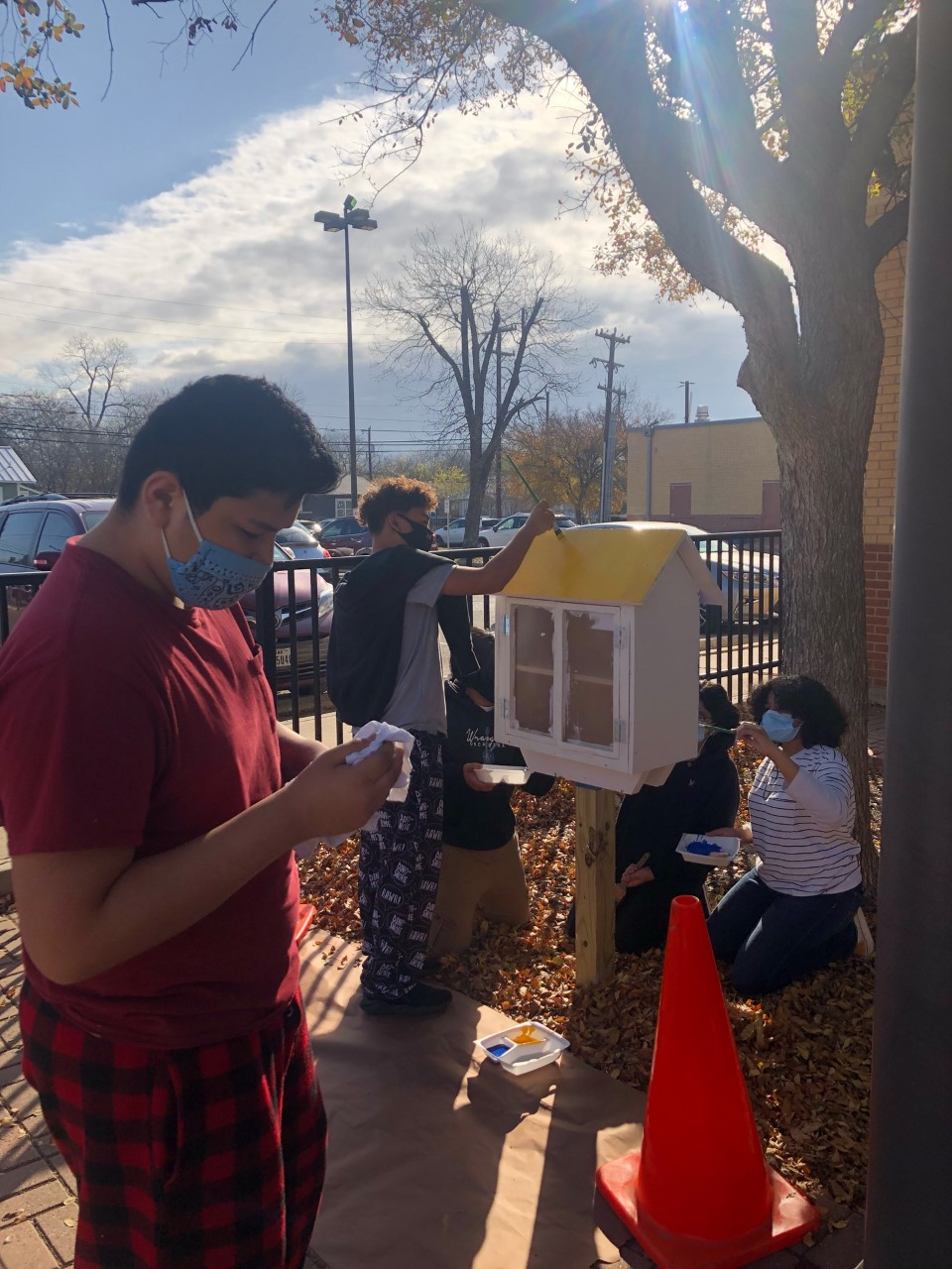 Students paint their little free library at Herff Academy, December 2020